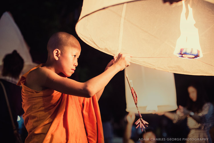 Young monk, Loi Krathong festival, Chiang Mai, Thailand by Adam Charles George Photography